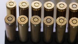 Dolly shot of large caliber ammunition bullets