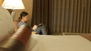 Dolly Shot Of Woman Looking At Her Smart Phone In A Hotel Sofa