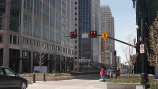 E Pedestrian walking across a cross walk in downtown Salt Lake City