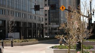 E Pedestrians walk across a cross walk in downtown Salt Lake City