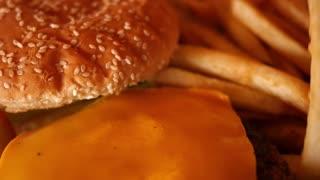 Eating fries and a burger at restaurant