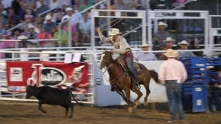 Editorial a calf roper at a PRCA Oakley rodeo slow motion