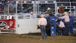 Editorial a calf roper cowboy in a PRCA Oakley rodeo slow motion