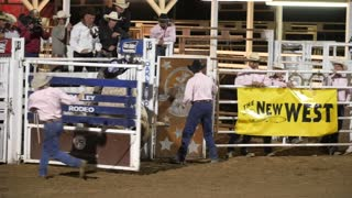 Editorial A cowboy rides a bull at the PRCA Oakley rodeo slow motion