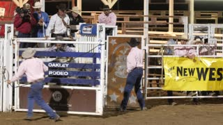 Editorial a cowboy riding a crazy bull at the PRCA Oakley rodeo slow motion