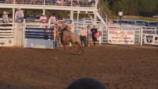 Editorial A Cowboy riding bareback in PRCA rodeo event