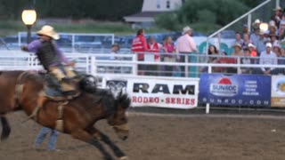 Editorial a saddle bronc at a PRCA Oakley rodeo slow motion