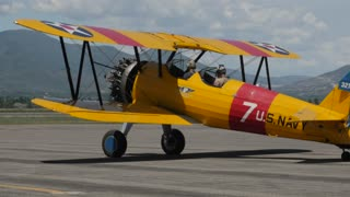Editorial biplane at a World War 2 traveling exhibit