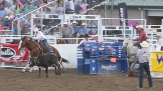 Editorial coboys team roping in a PRCA rodeo event slow motion