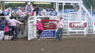 Editorial cowboy riding saddle bronc at a PRCA rodeo slow motion