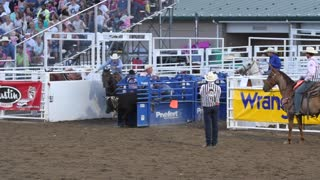 Editorial cowboys team roping at a PRCA oakley rodeo slow motion