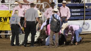 Editorial medical staff help injured bull rider at a PRCA rodeo slow motion