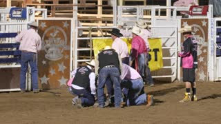 Editorial medics hovered over injured bull rider at a PRCA rodeo
