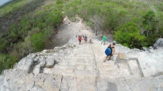 Editorial of people climb big stairs at Ek Balam Mayan ruins in Mexico