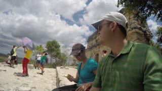 Editorial of people resting on top of ruin at Ek Balam Mayan in Mexico