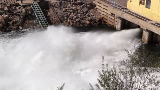 Emergency flood gates opened at dam