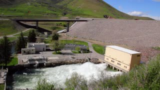 Emergency flood gates release water from below dam