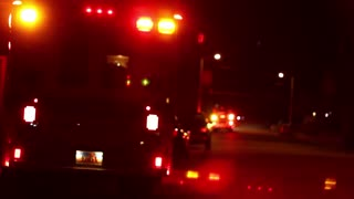Emergency Vehicles Flashing Lights at Night