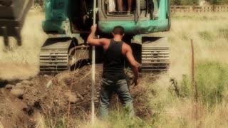 Excavation crew digging foundation