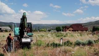 Excavation Crew Digging Hole