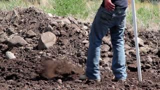 Excavator measuring dirt