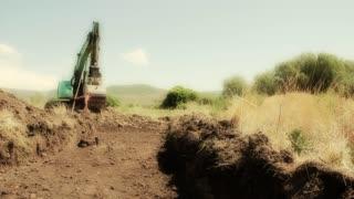Excavators working in desert heat