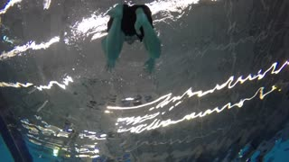 Extreme slow motion man treading underwater shot