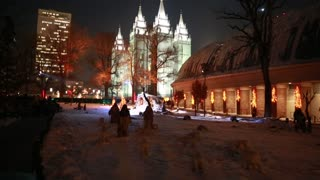 Family at the nativity in temple square at christmas
