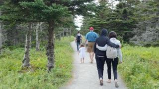 Family hikes the skyline trail in Cape Breton Nova Scotia Canada