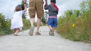 Family hiking on the skyline trail in Cape Breton Nova Scotia Canada