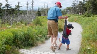 Family hiking on the skyline trail in Cape Breton Nova Scotia