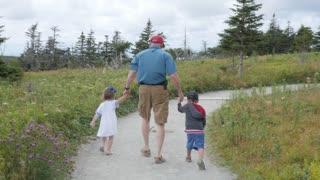 Family hiking the skyline trail in Cape Breton Nova Scotia