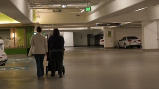 Family in parking garage