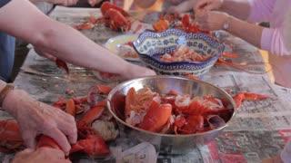 family preparing fresh lobster at dinner time