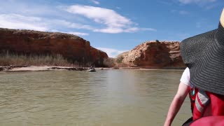 family rowing river rafts down the san juan river