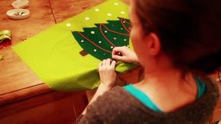 female sewing a advent calendar