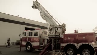 firefighter on fire truck latter