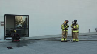 firefighters at a warehouse fire