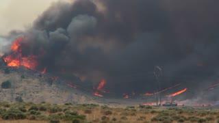Firefighters Battling Huge Wildfire