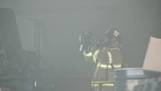 firefighters in smoky building