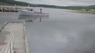 fishing boat entering a harbor jib shot