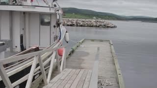 fishing boats entering a harbor jib shot