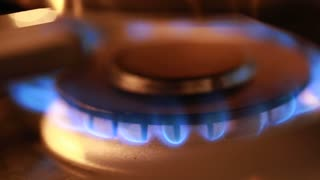 flame on a gas stove in kitchen