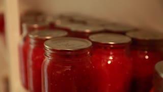 fresh preserved food in jars in storage room rack focus