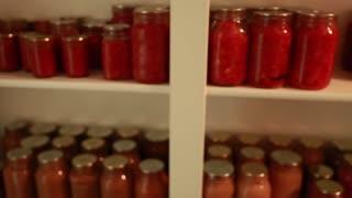 freshly preserved food in jars in storage room rack focus