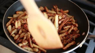 frying french fries on a stove