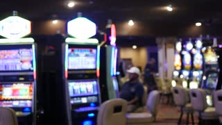 Gimbal shot of people gambling in a casino
