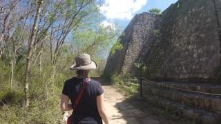 Gimbal Shot Of Woman Tourist Walking At Ek Balam Mayan Ruins