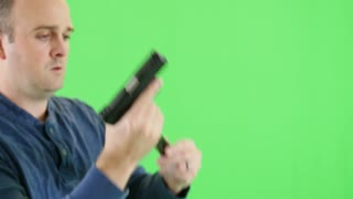 Green screen shot of a shooter with a 22 pistol