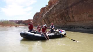 group rowing river rafts on the san juan river by cliff